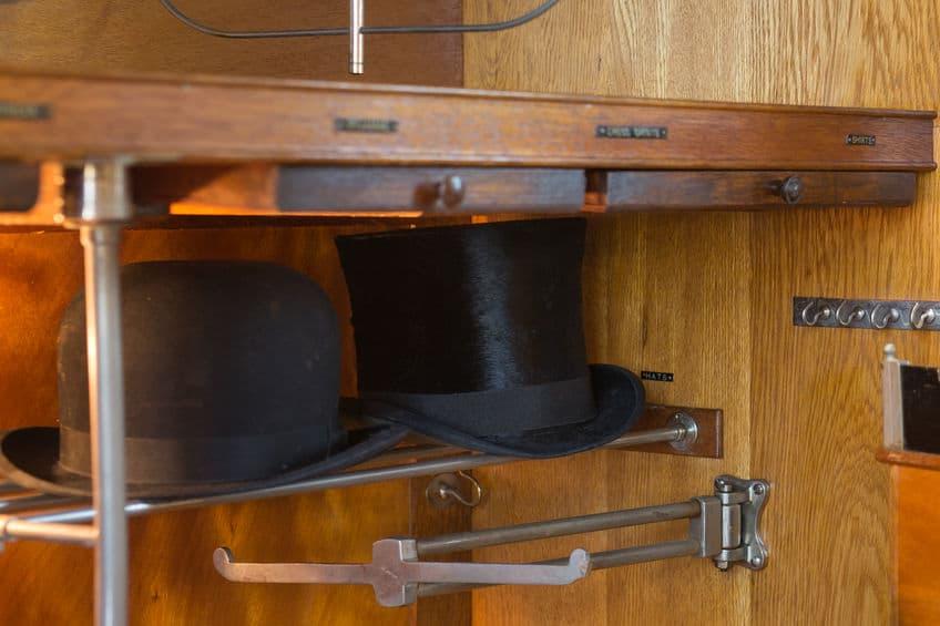 Top hat inside a hat storage cupboard