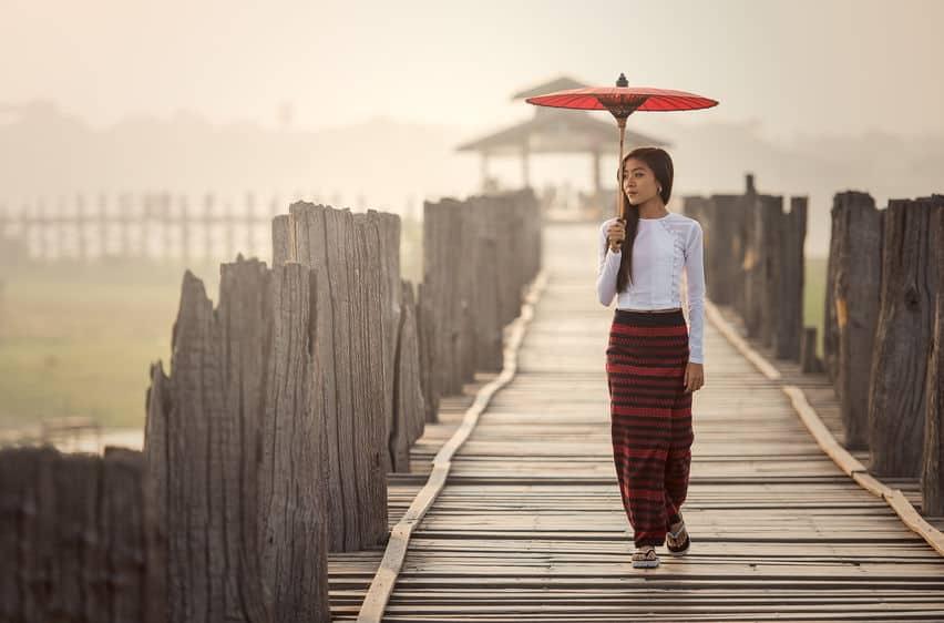 women holding a traditional umbrella