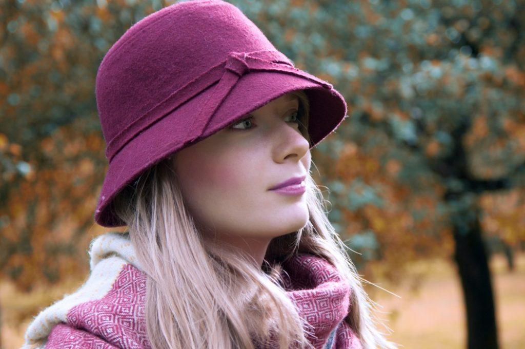 Women wearing purple cloche hat