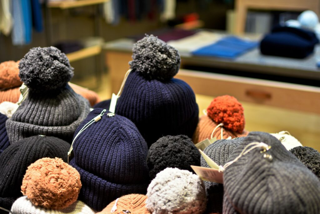 Selection of beanies with pom poms