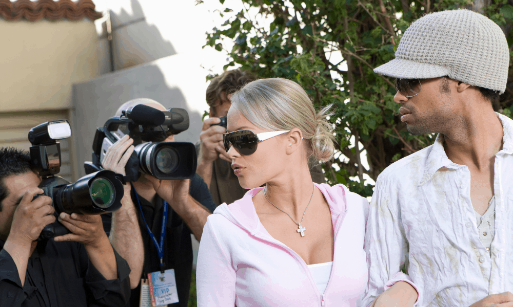 Celebrity wearing hat to hide from cameras