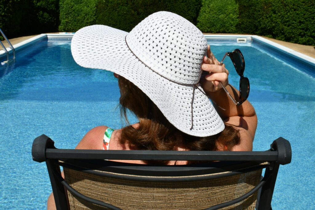 Women wearing a floppy sun hat