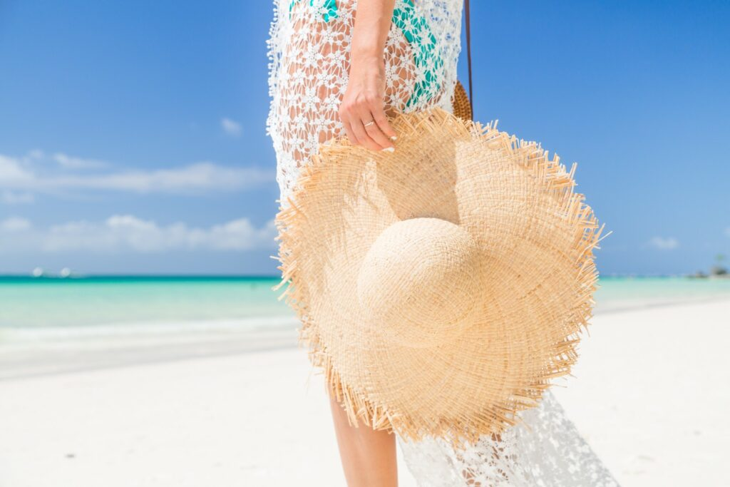 Women walking in sun with wide brimmed straw sun hat