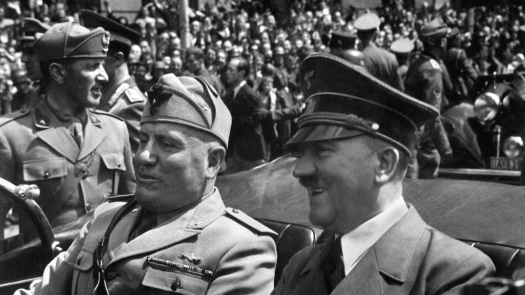 Hitler wearing cap next to Mussolini