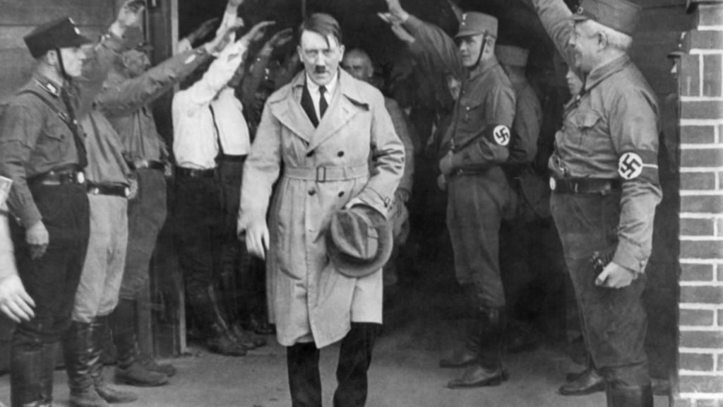 Hitler carrying a hat