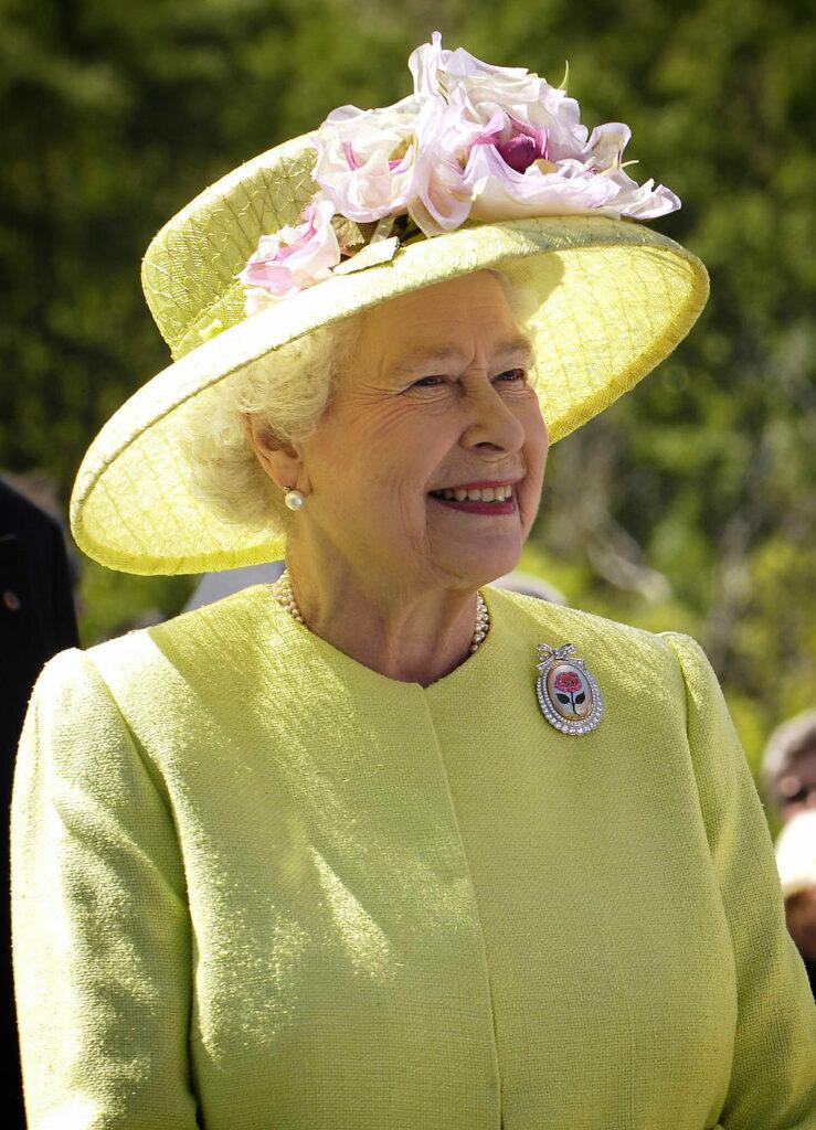 Queen Elizabeth II wearing yellow hat