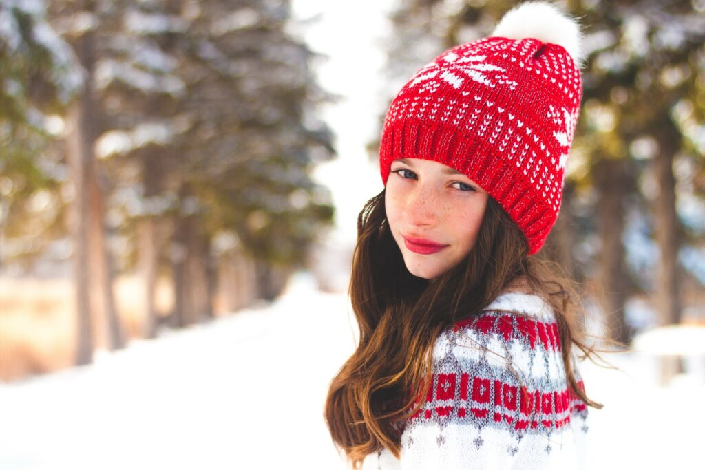 Girl wearing a red winter toque hat