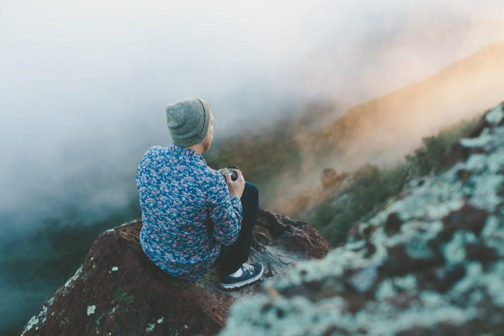man wearing a beanie on a mountain