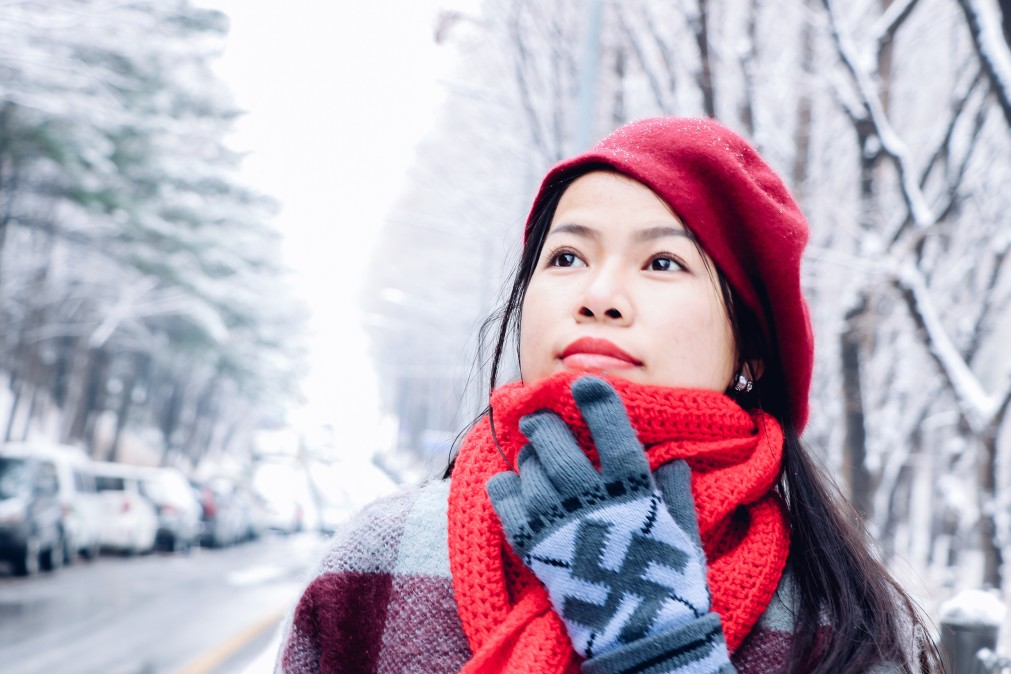woman wearing red scarf and hat