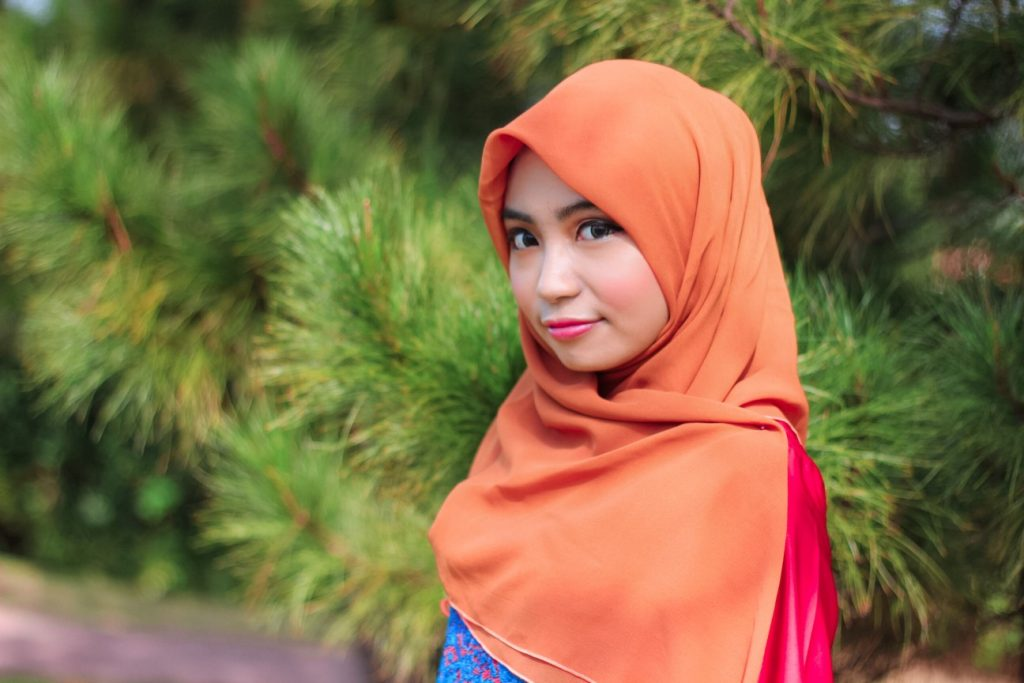 woman wearing orange hijab