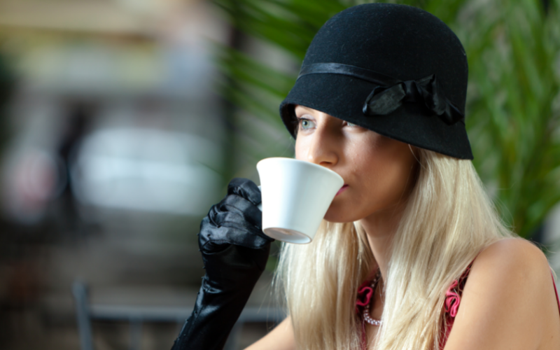 woman wearing a black clcohe hat