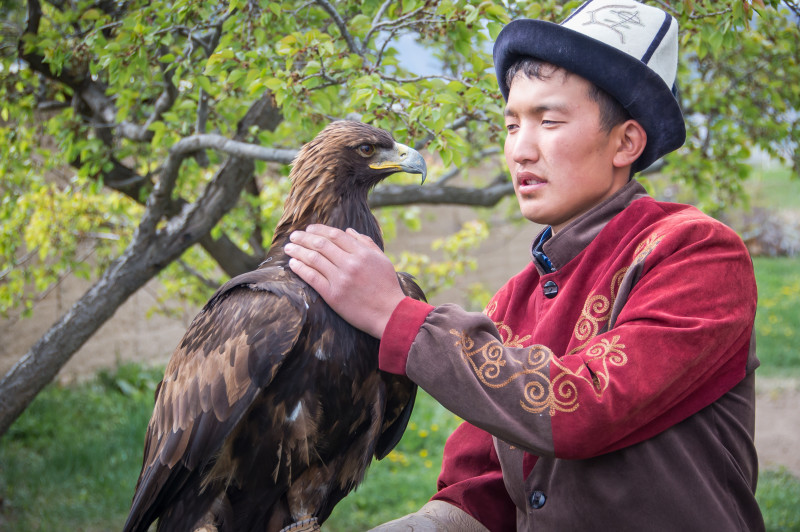 kyrgyzstan boy wearing a kalpak hat