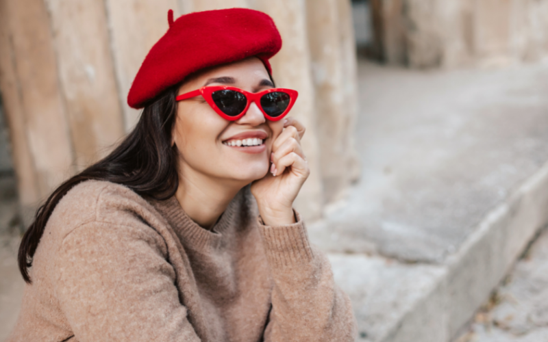 woman wearing a beret with glasses