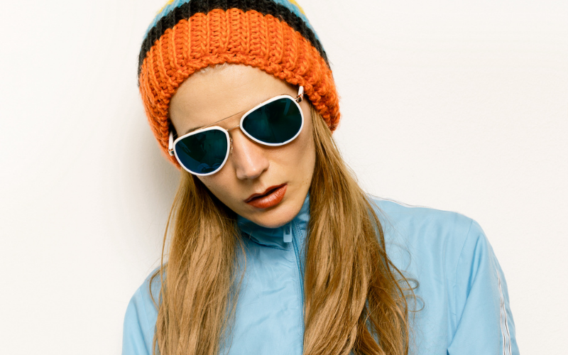 woman wearing a beanie with sun glasses