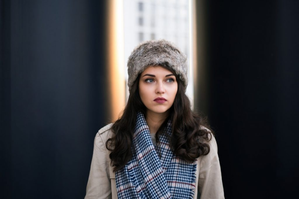 women wear a patterned scarf and hat