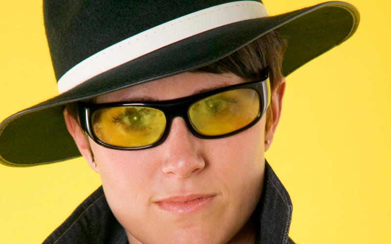 woman wearing fedora with glasses