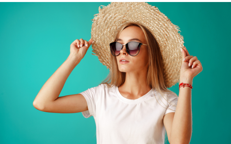 woman wearing straw floppy hat with sun glasses