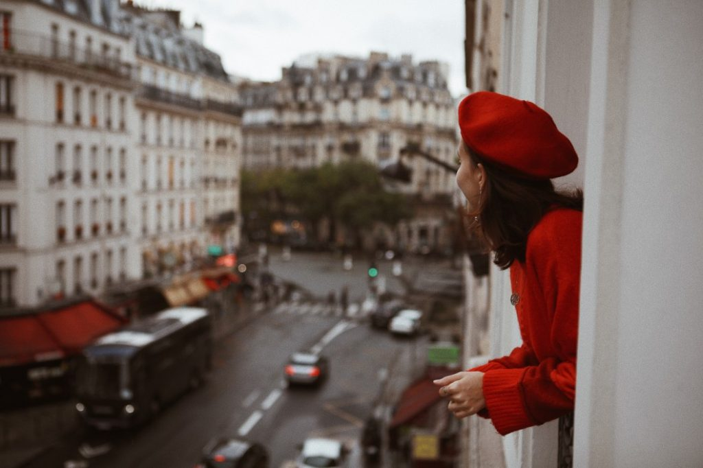 women bearing a red beret in Paris