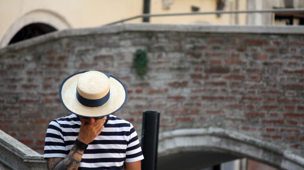 Man wearing a canotier hat
