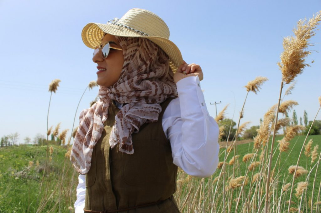 woman wearing straw hat with hijab