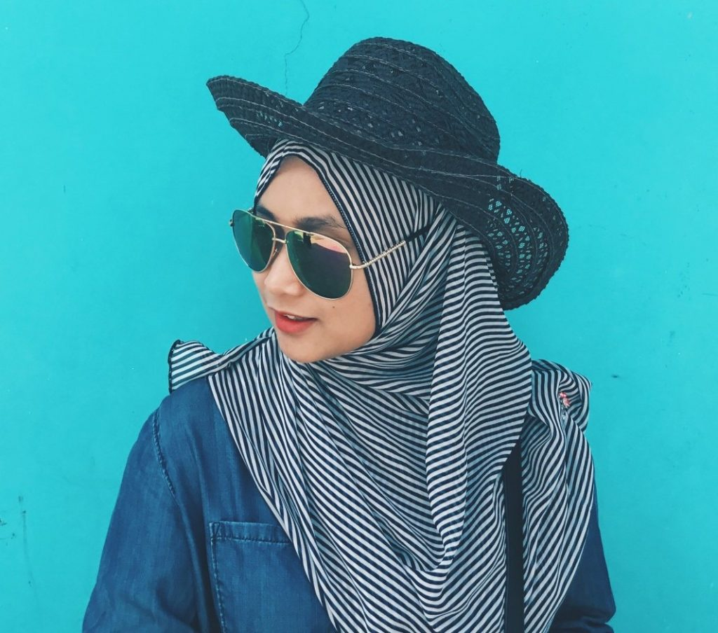 women wearing chic floppy hat with hijab