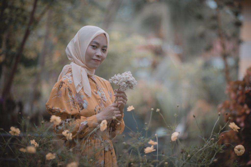 Woman wearing hijab with dress
