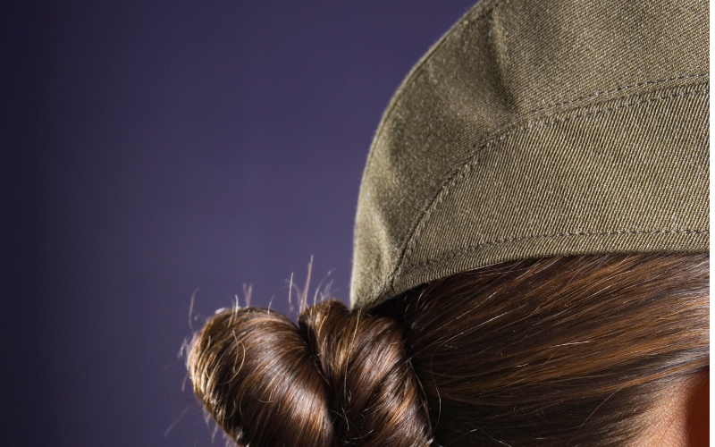woman wearing a hat with hair bun