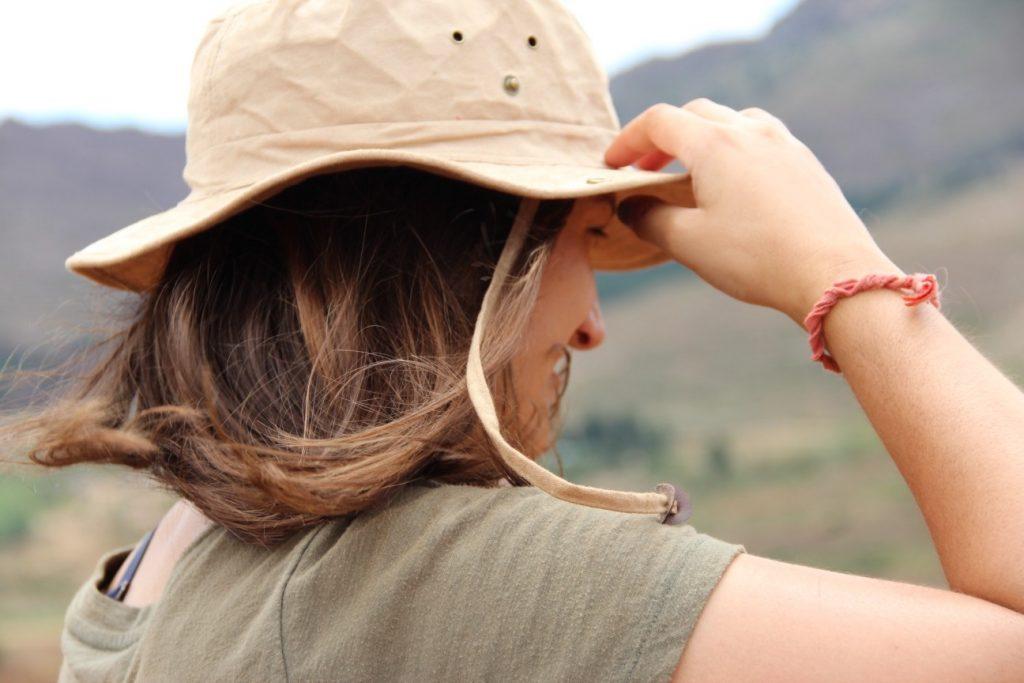 woman wearing safari hat